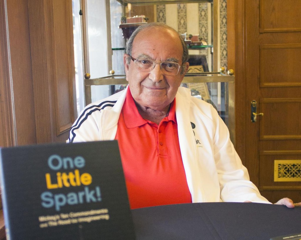 "Marty Sklar, former vice-chair of Walt Disney Imagineering, and a Disney Legend, sits inside the Disneyana Shop at Disneyland, ready to autograph copies of his book ""One Little Spark! Mickey's Ten Commandments and The Road to Imagineering"" for visitors to the theme park."